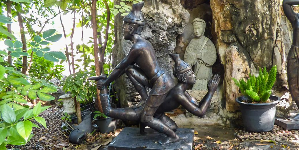 Thai massage statues at Wat Pho temple grounds in Bangkok