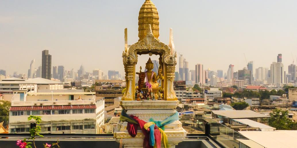 Thai Spirit house on roof top in Bangkok city