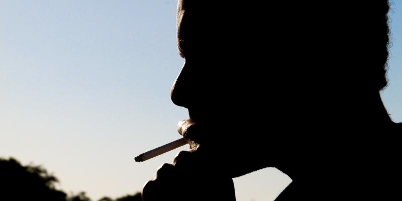 Silhouette of a man smoking