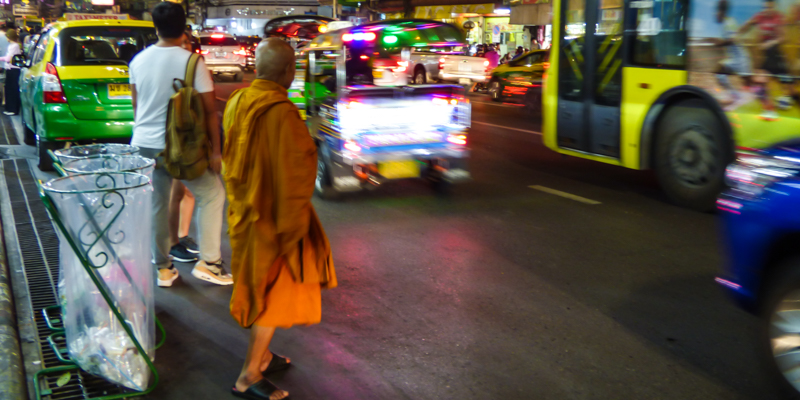 Monk crossing the street in Bangkok's Chinatown